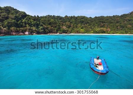 boat on paradise beach - stock photo