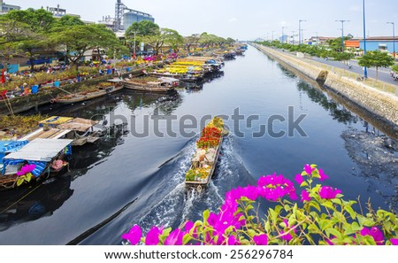 Boat on river Tau Hu in Ho Chi Minh city, Vietnam. ( Ben Binh Dong) - stock photo