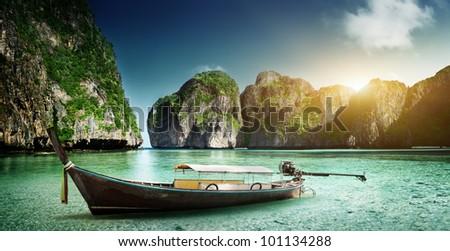 boat on sand of Maya bay Phi phi island - stock photo