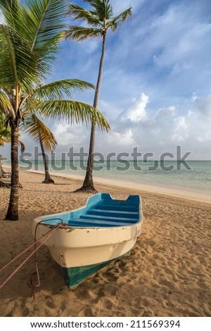 boat on sandy Tropical Caribbean beach - stock photo