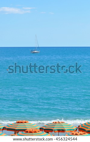 boat on sea with parasol beach