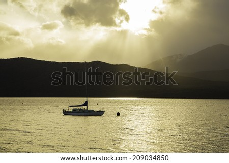 Boat on Te Anau River - stock photo