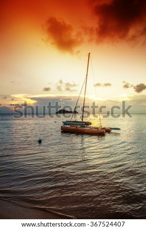 Boat on the beach against the backdrop of a beautiful sunset