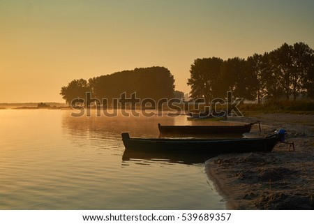 Boat on the beach at sunrise.