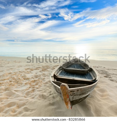 Boat on the beach at sunrise time