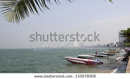 boat on the beach in Pattaya Thailand - stock photo