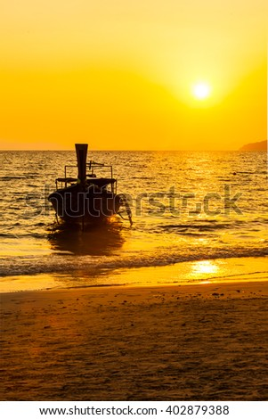 Boat on the beach with sunset