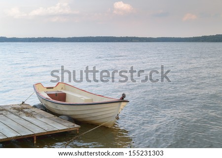 boat on the blue lake with cloudy sky, nature series