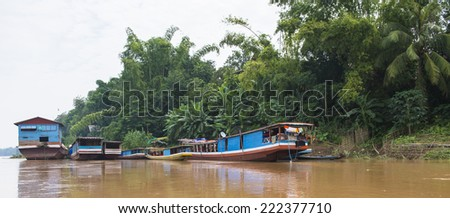 Boat on the Mekong river not far away from Luang Prabang - stock photo