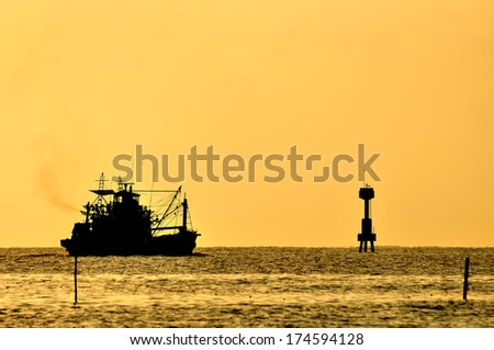 Boat on the sea at sunset - stock photo