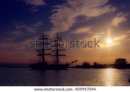 Boat on the sea at sunset in Jastarnia, Baltic Sea - stock photo
