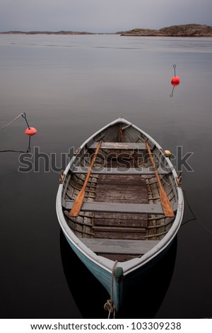 Boat on the serene water - stock photo
