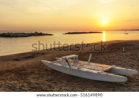 boat on the shoreline of rimini,italy,in summer