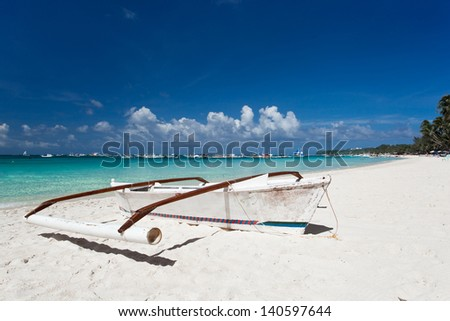 Boat on tropical beach with white sand - stock photo