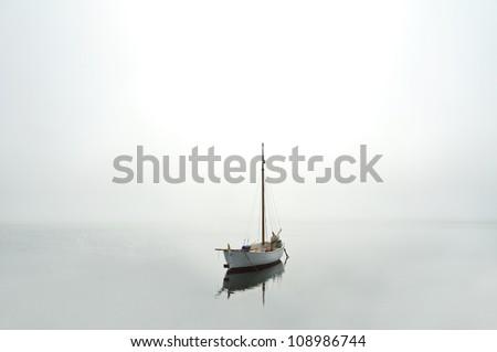 Boat on water near the coast - stock photo