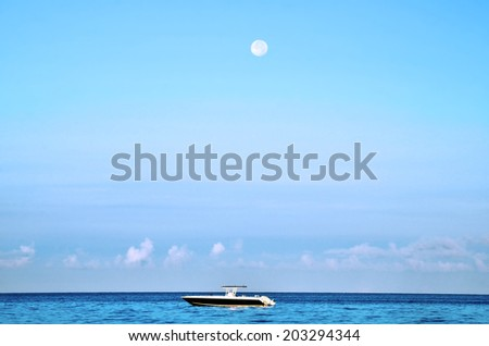 Boat parked under the moon - stock photo