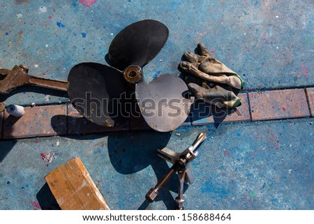 boat propeller improvement tools and gloves during a repair work - stock photo