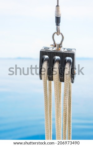 Boat pulley with clear sky and sea in the background - stock photo