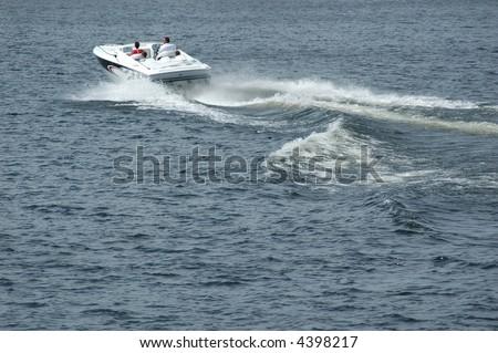 boat racing on lake - stock photo