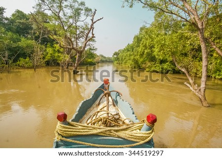 Boat ride in backwater jungle of India. Wild nature adventure trip.
