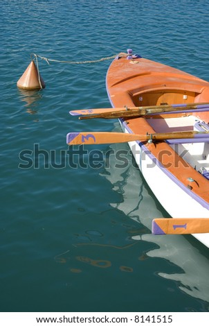 Boat rowing on mediterranean sea - stock photo