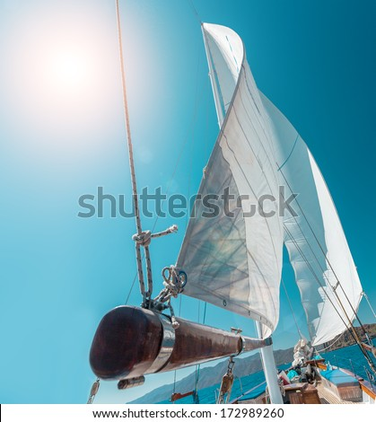 Boat sailing in Aegean Sea on a sunny day - stock photo