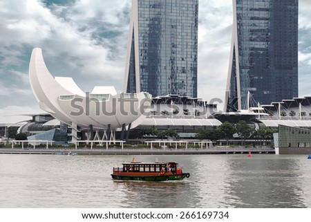 boat sailing in the bay of Singapore - stock photo