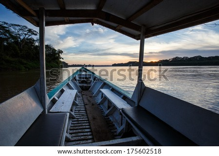 Boat sailing in the Madre de Dios river peru - stock photo