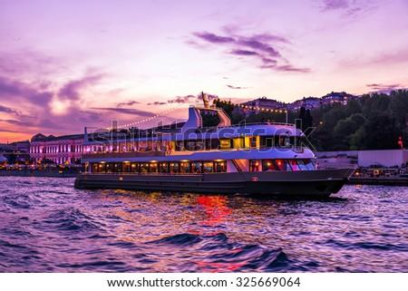 boat sailing in to night Bosphorus , Istanbul, Turkey - stock photo