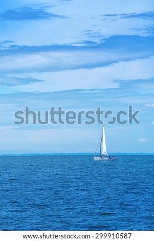 Boat Sailing on Open Blue Sea on Bright Summer Day