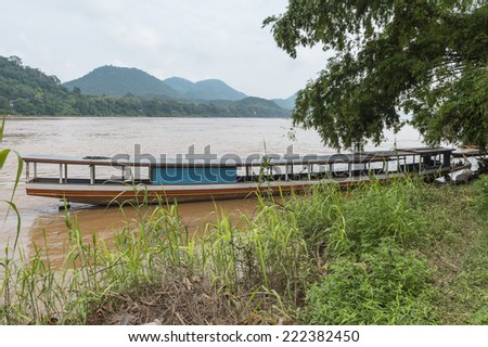 Boat sails over the Mekong river - stock photo