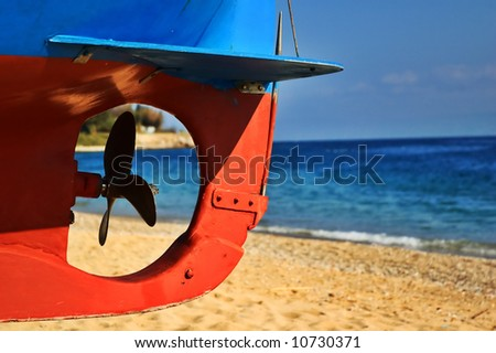 Boat screw with beach and sea in the background