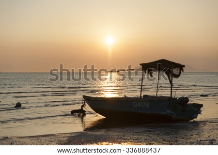 Boat seat on a beach with sunset