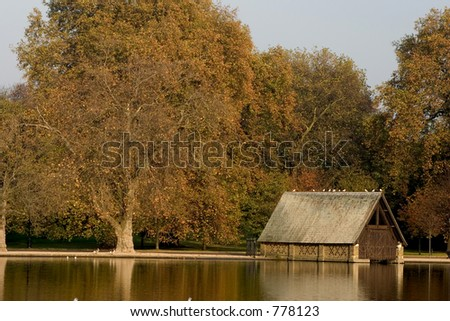 Boat shed on lake - stock photo