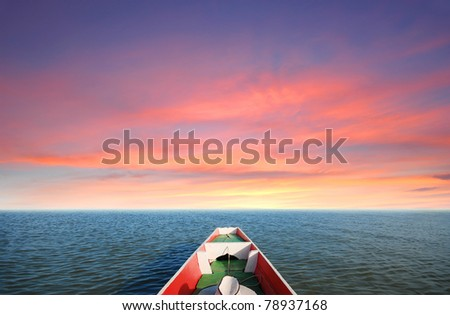 Boat sunset to destination in Thailand - stock photo