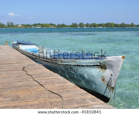 Boat tied to Pier; Utila, Bay Islands, Honduras