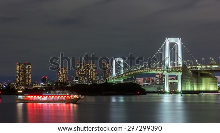 Boat Tour Dinner Yakatabune in Red Light Cruise Tokyo Bay with Rainbow Bridge, Tokyo City Skyline background from Odaiba at night in summer, Japan - stock photo