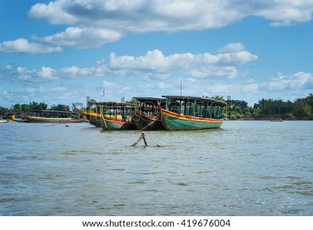 Boat tourists in port on lagoon for cloud background  - stock photo