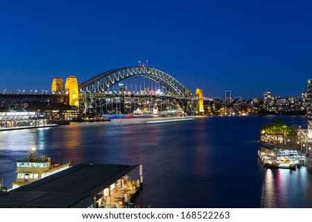 Boat traffic around Sydney harbour Bridge at rush hour on a winter's evening in Sydney, Australia