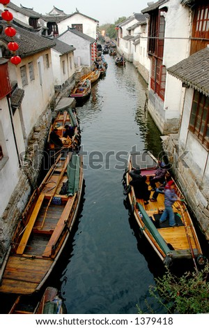 Boat traffic on the narrow river of a southern Chinese town. More with keyword Series11A. - stock photo