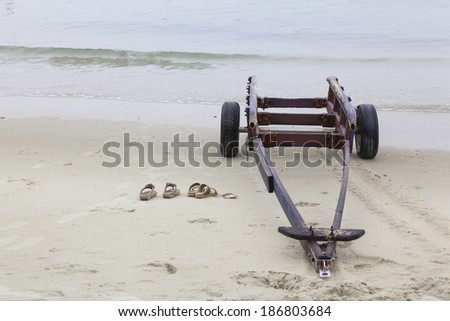 boat trailer at the beach - stock photo