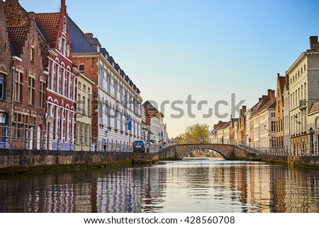 Boat trip on Canal in Bruges / Facades of old houses in Belgium / Summer day in city - stock photo