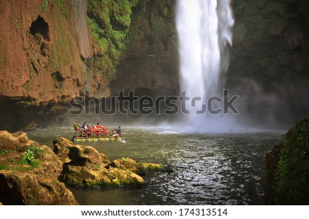 Boat under Ouzoud waterfall, Morocco  - stock photo