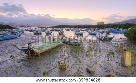 Boat, wetland at Bali of New Taipei City, Taiwan ~ Morning landscape with stranded boats on Tamsui river during a low tide, Taipei Taiwan  Beautiful sunrise in Tamsui river, Taipei Taiwan - stock photo
