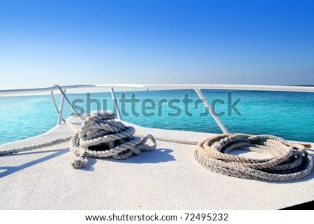 Boat white bow in tropical Caribbean sea summer relax vacations - stock photo