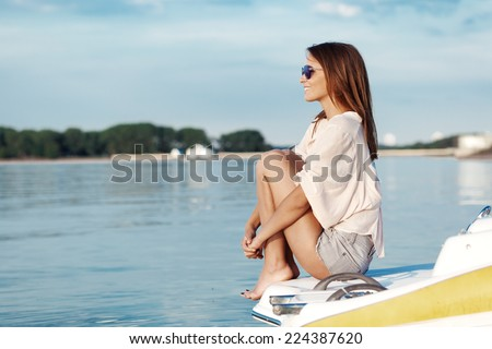 Boat woman smiling happy looking at the sea sailing by. - stock photo