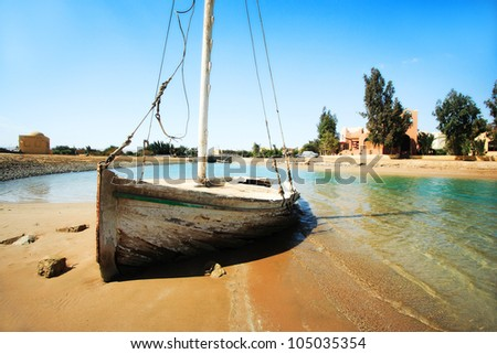Boat wreck on the desert island - stock photo
