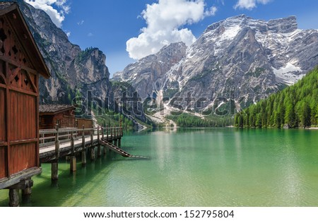 Boathouse at the Braies Lake in spring on a sunny day. - stock photo