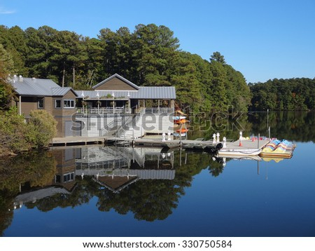 Boathouse on Lake Johnson in Raleigh, North Carolina in the fall. - stock photo