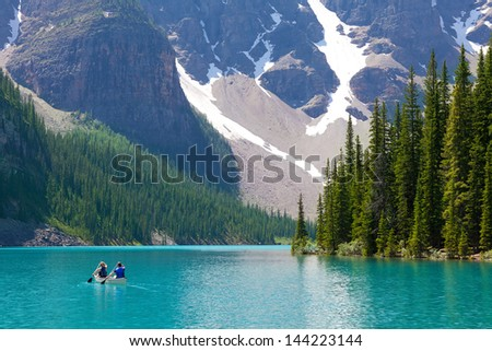 boating at beautiful moraine lake at banff national park, alberta, canada - stock photo